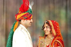 Indian couple in wedding attire. Beautiful Indian couple on their wedding day in their traditional attire Stock Images