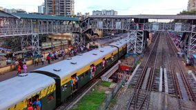 Indian crowded rail station with trains stock photo