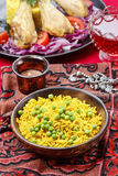 Indian cuisine: bowl of yellow rice Royalty Free Stock Images