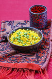 Indian cuisine: bowl of yellow rice with green peas Royalty Free Stock Images