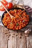 Indian cuisine: Chana masala with ingredients close-up. vertical Royalty Free Stock Photos
