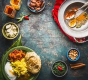 Indian cuisine food background with various traditional specialties meal and colorful spices on rustic background, top view. Frame Royalty Free Stock Image
