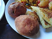 Indian food rice, bread, potato, vegetables. Goa, India. Indian cuisine food on plate - spicy rice, potato, vegetables, bread in Goa, India stock images