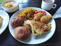 Indian food rice, bread, potato, vegetables. Goa, India. Indian cuisine food on plate - spicy rice, potato, vegetables, bread in Goa, India stock photo