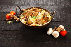 Indian cuisine-tasty fish pilaf or biriyani in cast iron pot, Royalty Free Stock Photos