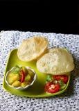 Indian cuisine, vegetarian preparation poori sabzi Royalty Free Stock Photos