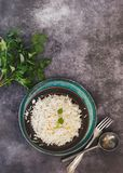 Indian jeera cumin flavoured rice. Indian cumin jeera cashew pulao rice. served in rustic bowl on tray.  Top view, blank space Stock Photos