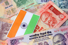 Indian currency. Indian flag and Indian currency concept of growing economy Stock Photos