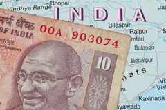 Indian currency. Indian rupees against the outline of India map Royalty Free Stock Photography