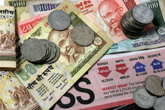 Indian Currency. Note and coins, on graphic showing recent stock market trend Royalty Free Stock Photo