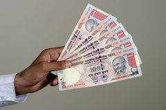 Indian currency. Close up of a  hand with indian currency holding tousand rupee notes Royalty Free Stock Photo