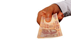 Indian Currency Bank note INR 10 in the hand. Man giving Indian banknote Rs 10 on white Royalty Free Stock Photography