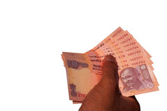 Indian Currency Bank note INR 10 in the hand. Man giving Indian banknote Rs 10 on white Royalty Free Stock Photos