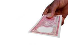Indian Currency Bank note INR 2 in the hand. Man giving Indian banknote Rs 2 on white Stock Image