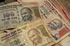Indian Currency. Chennai, Tamil Nadu, India : Indian currency of  Rupees 100, 500 and 1000 denomination, with photograph of Mahatma Gandhi, revered as Father of Royalty Free Stock Photography