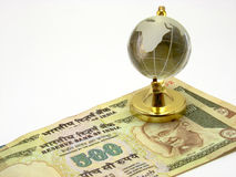 Indian Currency & Globe Stock Photography