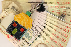 Indian currency and house shape key Stock Photo