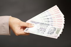 Indian currency notes. Hnad holding Indian currency notes Royalty Free Stock Images