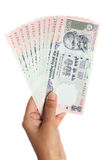 Indian currency notes. Hand holding Indian currency notes against white background Royalty Free Stock Photo