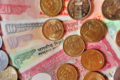 Indian Currency Notes and Coins. Stack of Indian currency coins of denomination Rs.5, Rs.2 and Re.1 placed on currency notes of denomination Rs.20, Rs.10 and Rs Royalty Free Stock Photos