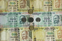 Indian currency notes with coins Stock Photos