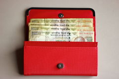 Indian currency notes in a ladies purse Stock Image