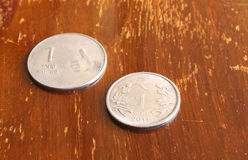 Indian Currency One Rupee Coin. Indian currency or money one rupee coin on a wooden background Stock Photos