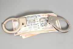 Indian Currency Rupee Notes and Handcuffs Stock Images