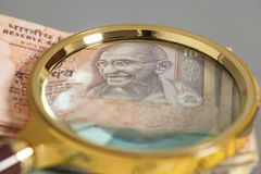 Indian Currency Rupee Notes with magnifying glass Stock Photography