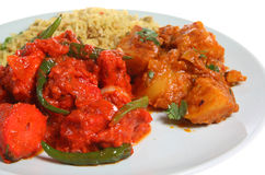 Indian Curry. Chilli chicken curry with rice and vegetables Royalty Free Stock Photography