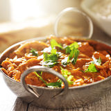 Indian curry - chicken tikka masala in balti dish. Indian curry chicken tikka masala in balti dish with warm lens flare in background and shot with selective Royalty Free Stock Photos