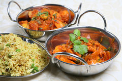 Indian Curry Dinner Meal. Selection of Indian dishes including Chilli Chicken, Bombay Aloo and Special Pilau Rice Stock Image