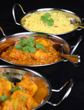 Indian Curry Dishes. Chicken dansak with Bombay aloo vegetable curry and rice Stock Photos