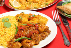 Indian Curry Meal. Indian chicken jalfrezi with Bombay aloo potato curry and lemon rice Royalty Free Stock Photos