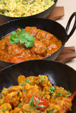Indian Curry Meal. Indian lamb vindaloo with vegetable curry and pilau rice Royalty Free Stock Photography