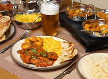 Indian Curry Meal. Indian chicken jalfrezi with Boambay aloo (potato curry), naan bread and rice. Shallow DoF, focus on the jalfrezi Royalty Free Stock Image