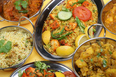 Indian Curry Meal. Selection of Indian curry dishes with rice and vegetables Stock Photo