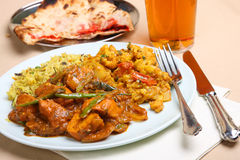 Indian Curry Meal. Indian chicken curry meal with keema naan and a pint of lager Stock Photography