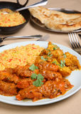 Indian Curry Meal. Chicken curry with vegetables, rice and naan Stock Photography