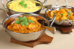 Indian Curry Meal. Chicken dansak curry with Bombay aloo and pilau rice Royalty Free Stock Image