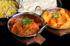 Indian Curry Meal. Indian chicken jalfrezi with potato curry and rice Royalty Free Stock Images