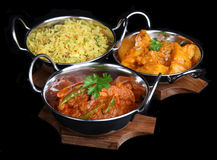 Indian Curry Meal. Indian Chicken Jalfrezi with Bombay Aloo and Pilau Rice Royalty Free Stock Images