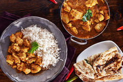 Indian curry meal. With balti dish, naan, and basmati rice Royalty Free Stock Photo