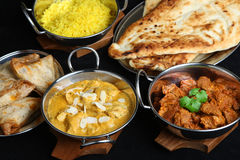 Indian Curry Meal Selection. Selection of Indian curries and accompaniments Royalty Free Stock Photo