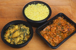 Indian Curry & Rice Ready Meal. Indian convenience food of chicken massala curry, saag aloo and pliau rice Royalty Free Stock Images