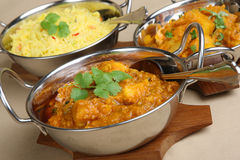 Indian Curry Selection. Chicken dansak with Bombay aloo and piau rice Stock Image