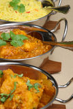 Indian Curry Selection. Chicken dansak with Bombay aloo and pilau rice Stock Photography