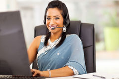 Indian customer service. Close up of beautiful indian business customer service operator in office Stock Images
