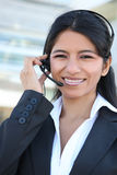 Indian Customer Service Woman. A pretty Indian customer service business woman at office building royalty free stock photo