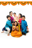 Indian Cute kids holding statue of Lord Ganesha or Ganapati on Ganesh festival or chaturthi, welcoming god. Asian small boys and g. Irls with Lord Ganesha Royalty Free Stock Images